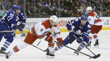 Carolina Hurricanes forward Jay McClement (18) tries to get by Toronto Maple Leafs forward Peter Holland (24) during the second period at the Air Canada Centre in Toronto on Thursday, Jan. 21, 2016. (John E. Sokolowski/USA Today Sports)