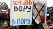 Protesters rally in St.Petersburg on Feb. 25 to demand the resignation of Prime Minister Vladimir Putin before the coming presidential vote. The placard reads: 'Everything fits for a good thief.' (Alexander Demianchuk/Reuters/Alexander Demianchuk/Reuters)