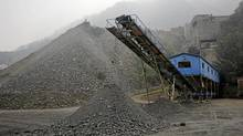 Ore is piled up for delivery at a mine owned by Silvercorp Metals Inc. in Jiyuan, China, on Sept. 27, 2011. A mining analyst believes Silver Standard Resources could be worth as much as $58. (Keith Bedford/Bloomberg/Keith Bedford/Bloomberg)