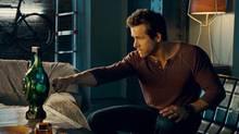 """Ryan Reynolds in a scene from """"Green Lantern"""" (AP)"""