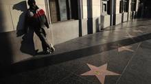 On Hollywood Boulevard, the glamour of the Walk of Fame is rebuked by the harsh realities endured by many people, in a state where a $15-billion deficit (due in part to ballot measures that have restricted taxes) threatens the social fabric. (Lucy Nicholson/Reuters)