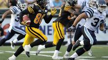 Hamilton Tiger-Cats wide receiver Chris Williams (L) runs for a touchdown past Toronto Argonauts Jeff Johnson (R) during the first half of their CFL game in Hamilton July 14, 2012. (MIKE CASSESE/REUTERS)