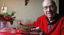 Morgan Ford, 92 of Tecumseh with the 134 year old fruitcake that has been in his family since the day his great-grandmother Fidelia Bates made it in the 1870's. Ford has been the caretaker of the fruitcake since 1952 when his father Lyman Ford gave it to him. Photographed on Tuesday Dec. 18, 2012. (Eric Seals/Detroit Free Press)