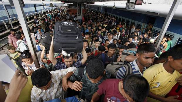 Indians originally from the northeastern states crowd as they disembark from a train originating in the southern city of Bangalore, in Gauhati, Assam state, India, Saturday, Aug. 18, 2012. Thousands of Indians from the northeast are leaving the southern city of Bangalore and other towns, spurred by rumors they would be attacked in retaliation for communal violence in their home state of Assam. (Anupam Nath/AP)