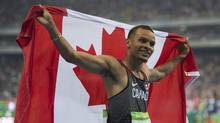 Canadian Andre De Grasse celebrates after winning bronze in the men's 100m race ath the Rio Olympics on August 14, 2016. (John Lehmann/The Globe and Mail)