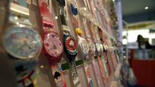 Swatch watches are displayed in a shop in Jerusalem in this file photo from Feb. 9, 2010. Swatch Group AG, which reported $1.5-billion in net income last year, says the name of a Tunisian non-governmental organization called I Watch is too similar to iSwatch, a brand it registered in 2007. (GIL COHEN MAGEN/REUTERS)