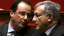 French head of the socialist party Francois Hollande, left, talks with former Finance Minister Dominique Strauss-Kahn at the National Assembly in Paris in this February 20, 2002, file photo. (CHARLES PLATIAU/Reuters/CHARLES PLATIAU/Reuters)