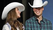 Prince William smiles at his wife Catherine, Duchess of Cambridge, during the Calgary Stampede on July 7, 2011. (TODD KOROL/Todd Korol/Reuters)