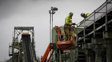 Workers make upgrades to the Prince Rupert Ridley terminal coal port onSept. 27, 2011. (JOHN LEHMANN/THE GLOBE AND MAIL)