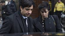 Former CBC radio host Jian Ghomeshi leaves a Toronto courthouse with his lawyer Marie Henein, right, following day six of his trial on Tuesday, Feb. 9, 2016. THE CANADIAN PRESS/Chris Young