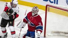 The shot by Ottawa Senators Erik Karlsson enters the net behind Montreal Canadiens goalie Carey Price as Ottawa Senators' Jean-Gabriel Pageau looks on during third period NHL hockey action in Montreal, Tuesday, November 22, 2016. (Peter McCabe/THE CANADIAN PRESS)