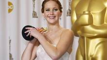 """Jennifer Lawrence, best actress winner for her role in """"Silver Linings Playbook,"""" poses with her Oscar backstage at the 85th Academy Awards in Hollywood, California, February 24, 2013. (MIKE BLAKE/REUTERS)"""