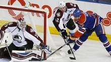 Apr 8, 2014; Edmonton, Alberta, CAN; Edmonton Oilers forward Matt Hendricks (23) is stopped by Colorado Avalanche goaltender Jean-Sebastien Giguere (35) during the second period at Rexall Place. (Perry Nelson/USA Today Sports)