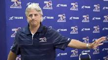 Then-Montreal Alouettes general manager Jim Popp leaves a news conference in Montreal on Thursday, August 1, 2013. (Paul Chiasson/THE CANADIAN PRESS)