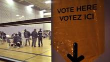 Voters cast their ballots at a poling station in brampton, October 6, 2011. (J.P. MOCZULSKI For The Globe and Mail)