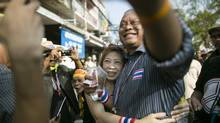 Anti-government campaigner Suthep Thaugsuban, shown with a supporter in Bangkok Jan. 9, says he's not asking for a military coup in Thailand: 'We will do this ourselves.' (Wason Wanichakorn/AP)