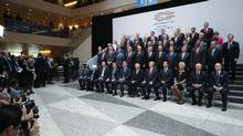 Group of 20 Finance Ministers and central bank governors pose for a photograph in the lobby of the International Monetary Fund headquarters during the World Bank Group and IMF Spring Meetings April 21, 2017 in Washington, DC. (Chip Somodevilla)