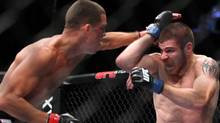 Nate Diaz, left, lands a punch against Jim Miller during their lightweight bout at UFC on Fox at the Izod Center in E. Rutherford, NJ on Saturday, May 5, 2012. Diaz won via tapout due to a choke in round 2. (AP Photo/Gregory Payan) (Gregory Payan/AP)