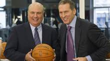 Toronto Raptors new vice-president of basketball operations Ed Stefanski (left) poses with GM Bryan Colangelo following a news conference in Toronto. (Frank Gunn/The Canadian Press/Frank Gunn/The Canadian Press)