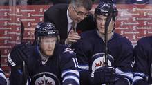 Winnipeg Jets' head coach Claude Noel talks to Mark Scheifele (55) during first period NHL action in Winnipeg on Monday, November 4, 2013. Noel says he has faith the worst power play in the league will improve.In 71 tries, the Jets (9-9-2) have managed to score only six goals this season. (JOHN WOODS/THE CANADIAN PRESS)