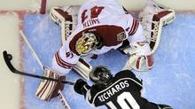 Los Angeles Kings center Mike Richards, below, shoots on Phoenix Coyotes goalie Mike Smith during the first period in Game 4 of the NHL hockey Stanley Cup Western Conference finals, Sunday, May 20, 2012, in Los Angeles. (AP Photo/Mark J. Terrill) (Mark J. Terrill)