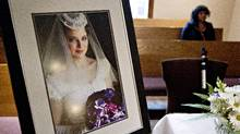 A photo of Michelle Shegelski in her wedding dress sits on a table at her funeral in Edmonton Alberta on Tuesday, June 26, 2012. (Jason Franson/THE CANADIAN PRESS)