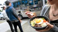 The Coma Food truck serves up interesting fusion of Korean/Mexican/American food on the streets of downtown Vancouver. (SIMON HAYTER FOR THE GLOBE AND MAIL)