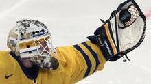 Sweden's goalie Jhonas Enroth makes a save against Canada during their 2013 IIHF Ice Hockey World Championship quarter-final game at the Globe Arena in Stockholm May 16, 2013. (ARND WIEGMANN/REUTERS)