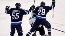 Winnipeg Jets centre Mark Scheifele (55) and right wing Patrik Laine (29) celebrate Laine's second goal of the game against the Dallas Stars during third period NHL hockey action in Winnipeg, Tuesday, February 14, 2017. (Trevor Hagan/THE CANADIAN PRESS)