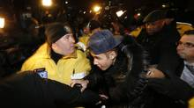Justin Bieber arrives Wednesday at a police station in Toronto, where he was charged with assault. Mr. Bieber has a court date on March 10 on allegations he hit a limousine driver in the early morning of Dec. 30. (ALEX UROSEVIC/REUTERS)