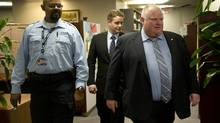 Brian Johnston is walked throught the office by Mayor Rob Ford and a security person at city hall in Toronto, Ont. Thursday, May 30, 2013. (Kevin Van Paassen/The Globe and Mail)
