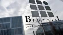 This file photo taken Jan. 16, 2016 shows the logo of the Biotrial laboratory on its building in Rennes, western France, where a clinical trial of an oral medication left one person brain-dead and five hospitalized. The man who had been left brain-dead in a French drug trial has died, the Rennes hospital said Jan. 17, 2016. (LOIC VENANCE/AFP/Getty Images)