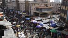 Pedestrians shop for wares in a market in Lagos, Nigeria. (Sunday Alamba/The Associated Press)