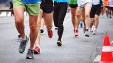 City Runners (Tibor Nagy/Getty Images/iStockphoto)