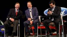 Ford Motor CEO Alan Mulally (L) laughs with Ford Executive Chairman Bill Ford (C) and COO Mark Fields during a press conference announcing Fields as Mulally's replacement as Ford Motor CEO as of July 1. (REBECCA COOK/REUTERS)