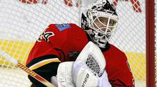 Calgary Flames goalie Miikka Kiprusoff, from Finland, stops a shot during first period NHL hockey action against the Chicago Blackhawks in Calgary, Feb. 3, 2012. (Jeff McIntosh/The Canadian Press/Jeff McIntosh/The Canadian Press)