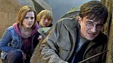 Emma Watson, Rupert Grint and Daniel Radcliffe are shown in a scene from Harry Potter and the Deathly Hallows: Part 2. (Jaap Buitendijk)