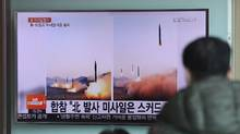 A man watches a TV news channel airing images of North Korea's ballistic missile launch published in North Korea's Rodong Sinmun newspaper at the Seoul Railway Station in Seoul, Tuesday, March 7, 2017.