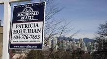 A for sale sign outside condos overlooking the skyline in Vancouver's Fairview neighbourhood on March 4, 2013. (Rafal Gerszak For The Globe and Mail)