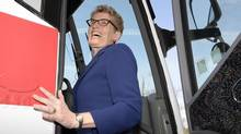 Ont. Liberal leader Kathleen Wynne gets on her campaign bus in Toronto on Monday May 5, 2014.