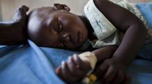 A young girl with malaria rests in the inpatient ward of the Malualkon Primary Health Care Center in Malualkon, in the South Sudanese state of Northern Bahr el Ghazal, June 1, 2012. A British drug firm's clinical trials have moved the prospect of a malaria vaccine closer to market. (ADRIANE OHANESIAN/REUTERS)