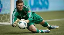 Toronto FC goalkeeper Joe Bendik makes a save against the Vancouver Whitecaps during the first half of an MLS game in Vancouver, B.C., on Saturday March 2, 2013. (DARRYL DYCK/THE CANADIAN PRESS)