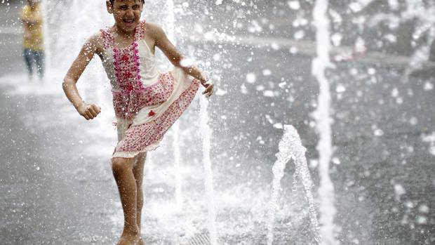 A girl plays with water fountains in a public square in Vienna. The shallow depth of field keeps the attention on the girl and doesn't let the water drops get in the way. When shooting through moving things like water, leaves or confetti try using a shallow depth of field to keep the focus on your main subject. (Lisi Niesner/REUTERS)