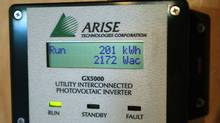 File photo of an Arise Technologies Corporation grid-connected photovoltaic inverter power meter indicates the wattage being generated by the roof-integrated solar panels at a Cook Homes model solar home in Waterloo. (J.P. MOCZULSKI For The Globe and Mail)