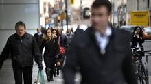 Increasing borrowing costs, teaching financial literacy, cracking down on payday loans and rethinking mortgage lending practices are some strategies to curb Canada's borrowing binge. (Fred Lum/The Globe and Mail)