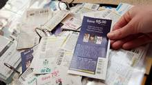 On average, Canadian couponing policies are less generous than in the U.S. Cassie Howard runs mrsjanuary.com, a couponing website. She keeps a coupon binder, has a large stockpile of purchased goods in her basement. She is seen clipping coupons in her Mississauga home on January 23, 2011. JENNIFER ROBERTS FOR THE GLOBE AND MAIL (JENNIFER ROBERTS For The Globe and Mail)