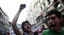 Protesters in Madrid demonstrate over high youth unemployment on April 7, 2011. (Susana Vera/REUTERS)