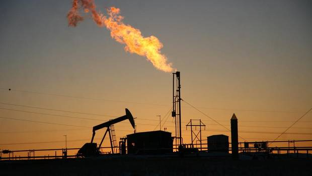 Bright natural gas flares dot the North Dakota landscape amid an oil boom that is changing the energy dynamics of North America. (NATHAN VANDERKLIPPE/THE GLOBE AND MAIL)