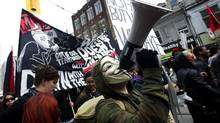 Members of the Occupy Toronto movement participate in a May Day march along Queen Street in Toronto, Ont. Tuesday, May 1/2012. (Kevin Van Paassen/The Globe and Mail)