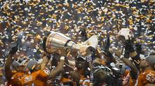 B.C. Lions celebrate their 2011 hometown win. (JOHN LEHMANN/The Globe and Mail)